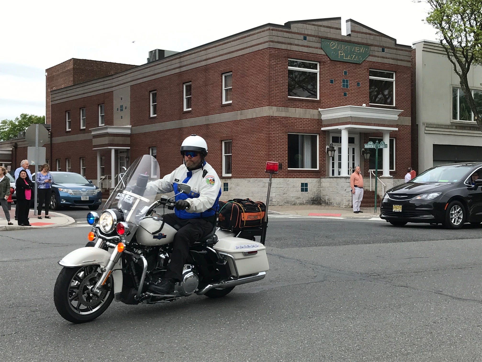 A motorcycle helps lead the Police Unity Tour that traveled through Somerville on Thursday.