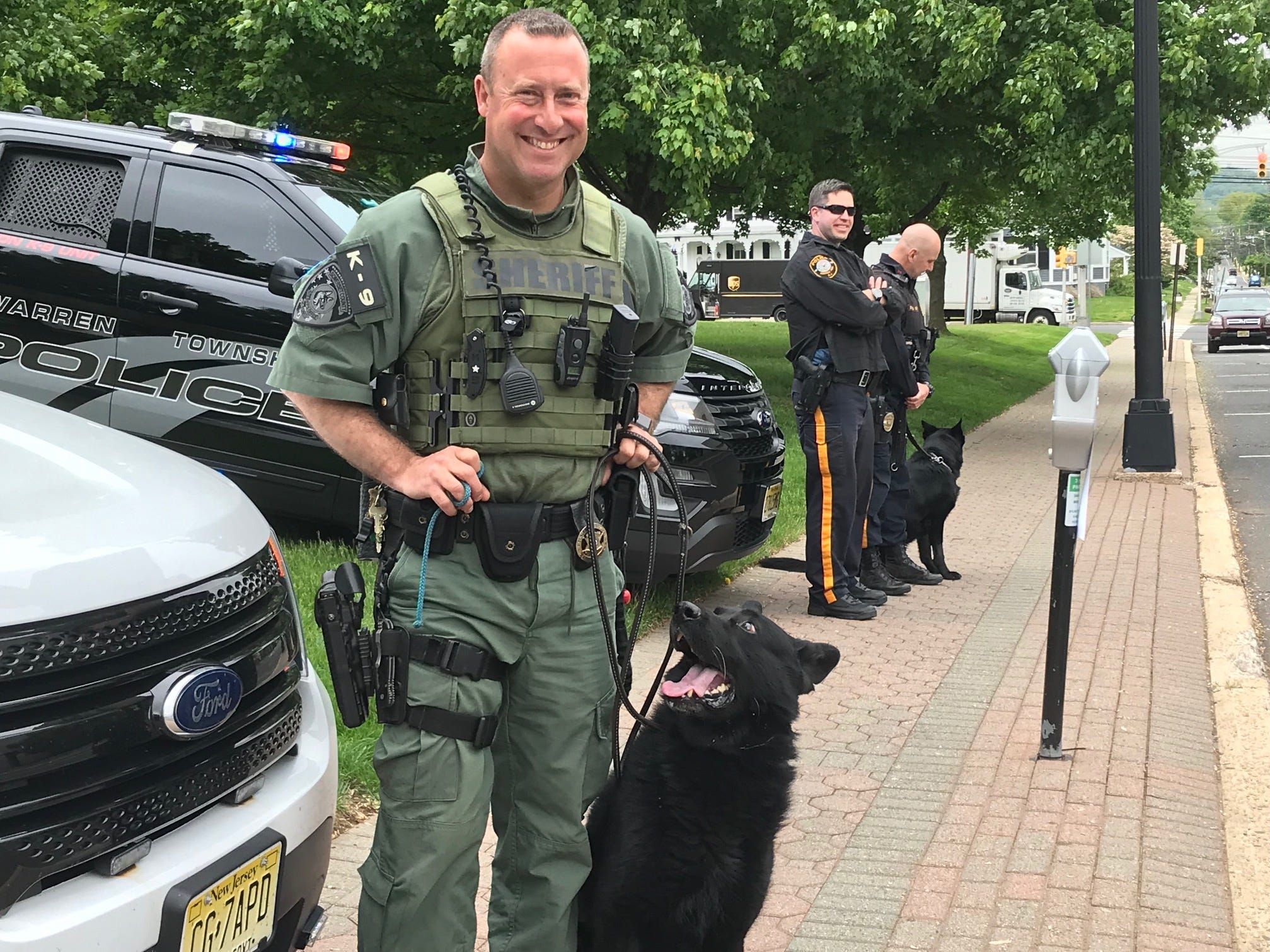 Somerset County Sheriff's Office David Daneker and his K-9 partner Apex awaiting the arrival of riders in the Police Unity Tour in Somerville.