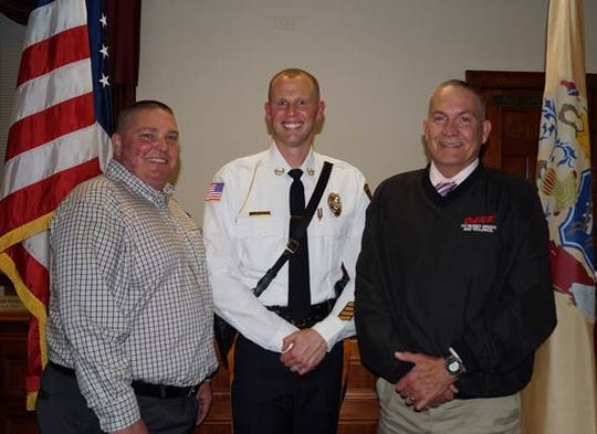 Retired Dunellen Police Chief Jeff Nelson, newly appointed Dunellen Police Chief Daniel Smith and retired Chief Gerard Cappella.