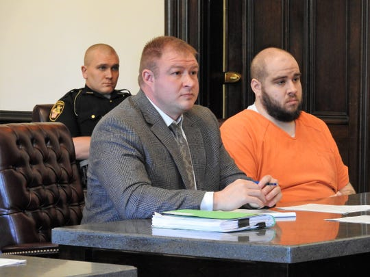 Attorney Zachuary Meranda with client Daniel Kovacs this week in Coshocton County Common Pleas Court. Kovacs received 30 months in prison in two cases relating to possession of heroin and methamphetamine and illegally carrying a weapon.