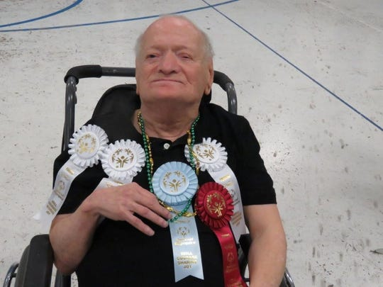 Richie Myers, a longtime resident of the state-run Glenwood Resource Center, with several Special Olympics ribbons he won in 2015. He died April 19, 2019.