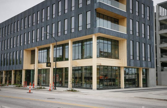 The building at 111 East Grand in Des Moines' East Village is the first in the city that was build using mass timber.
