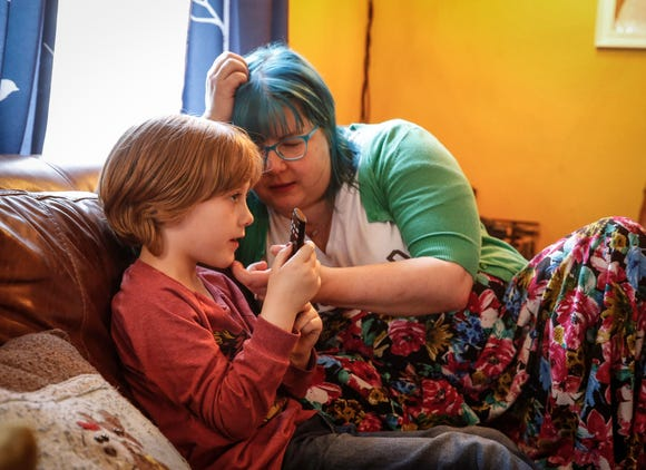 Kelly Meek talks with her adopted son, Griffin, 6, after school on Tuesday, May 7, 2019, at their home in Des Moines.