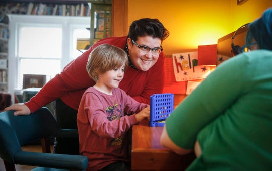 Erin Meek advises her son, Griffin, 6, on where to play a move during a game of Connect Four with his mom, Kelly,  after school at their home in Des Moines on Tuesday, May 7, 2019.