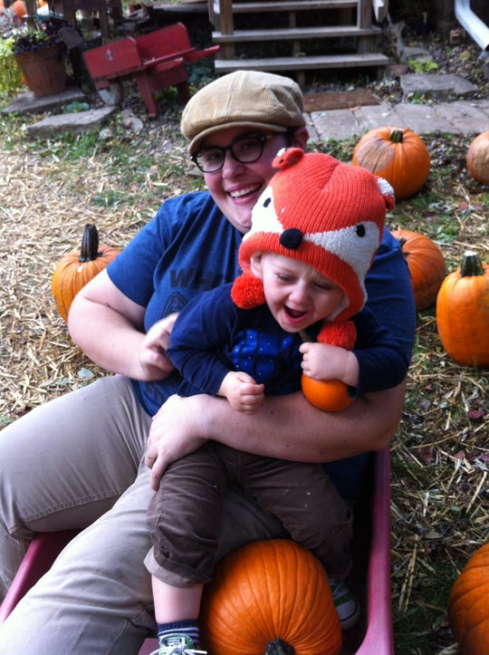Griffin at a pumpkin patch with mom, Erin