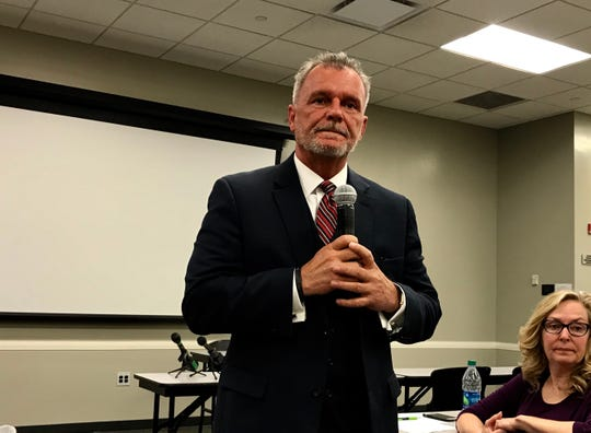 Iowa Medicaid Director Mike Randol listens to a question at a town hall meeting in Des Moines Wednesday, May 8, 2019.