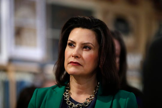 In this March 18, 2019, file photo, Michigan Gov. Gretchen Whitmer listens to Democratic presidential candidate Sen. Kirsten Gillibrand, D-N.Y., in Clawson, Mich.