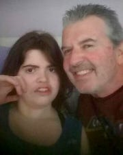 Robert Silvani Jr., 53, poses for a photo with his daughter Jessica Erin Silvani, 24.