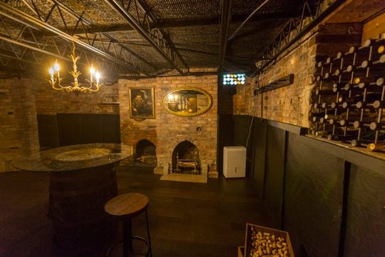 The bootleggers'old, brick secret room -- hidden behind a bookcase -- is now the below-ground wine room in this Medieval style house on a canal, It has a passage to an even more secret room, now closed off, that held wire frames for hammocks, perhaps fugitives.