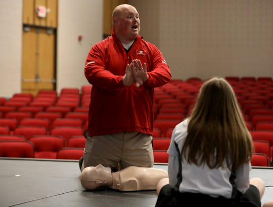Nick Ploucha explains CPR to his ninth grade health class at Dearborn Divine Child Catholic School in Dearborn, Michigan on Wednesday, May 8, 2019. Ploucha is part of a shared time program that allows public school teachers to teach various electives in private schools. He's technically employed by the Crestwood School District.