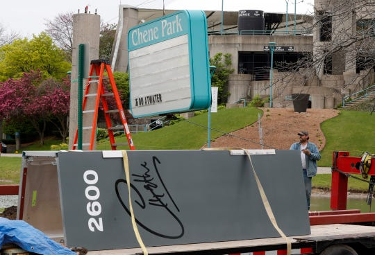 """Steve Sanford, of Johnson Sign Co., helps remove the Chene Park sign before replacing it with the new Aretha Franklin signage, Thursday, May 9, 2019, in Detroit. Mayor Mike Duggan told mourners at the Queen of Soul's funeral in August that the name would be changed, saying that """"when Franklin sang, it sounded like the voice of Detroit."""" Days later, City Council unanimously approved it. The facility is known for its outdoor stage and summer concerts. Franklin died Aug. 16 at 76."""