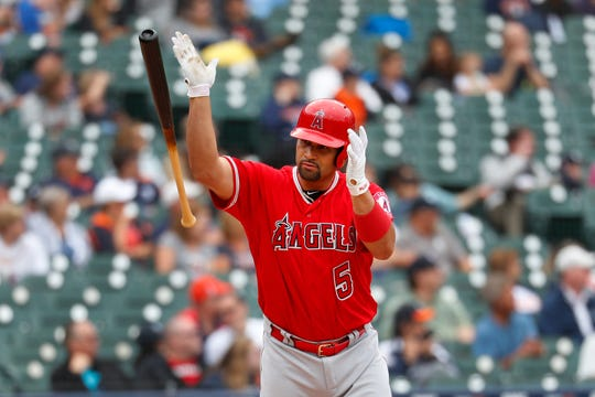 Los Angeles Angels slugger Albert Pujols tosses his bat after hitting a solo home run in the third inning Thursday, collecting his 2,000th career RBI.
