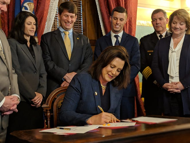 Michigan Gov. Gretchen Whitmer signs civil asset forfeiture reform laws on May 9, 2019. During the ceremony, she threatened to veto Senate-approved and House-passed no-fault auto insurance legislation unless there were changes.