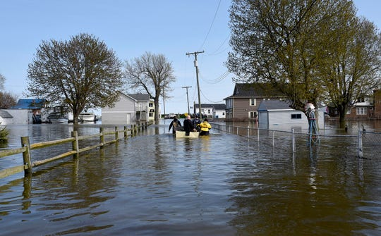Wind-driven water caused flooding in Estral Beach in Berlin Township, along western Lake Erie, following rainfall that contributed to high water levels in the Great Lakes in May.