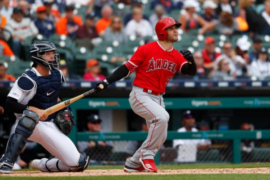 The Los Angeles Angels' Tommy La Stella blasts the first of his two home runs Thursday, and one of five hit by the Angels against the Tigers.