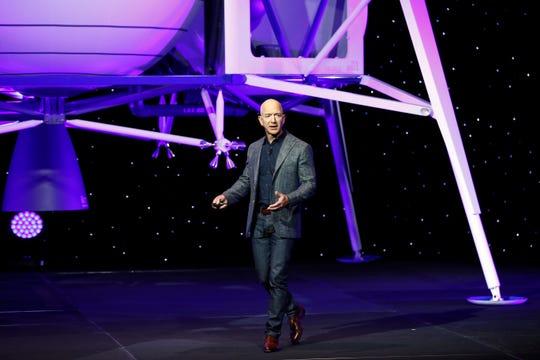 Jeff Bezos speaks in front of a model of Blue Origin's Blue Moon lunar lander, Thursday, May 9, 2019, in Washington.
