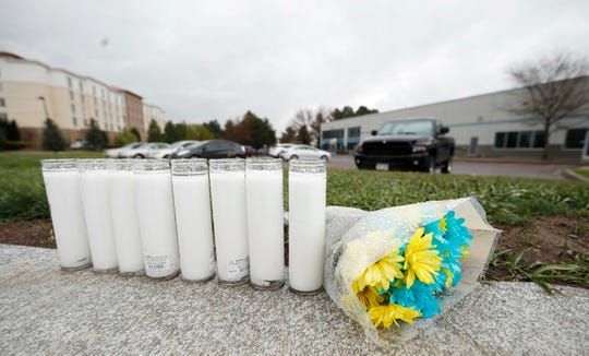 A bouquet of flowers sits next to a row of candles outside the STEM School Highlands Ranch late Wednesday, May 8, 2019, in Highlands Ranch, Colo.