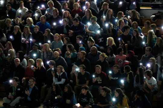Attendees illuminate their mobile telephones during a community vigil to honor the victims and survivors of yesterday's fatal shooting at the STEM School Highlands Ranch, late Wednesday, May 8, 2019, in Highlands Ranch, Colo.