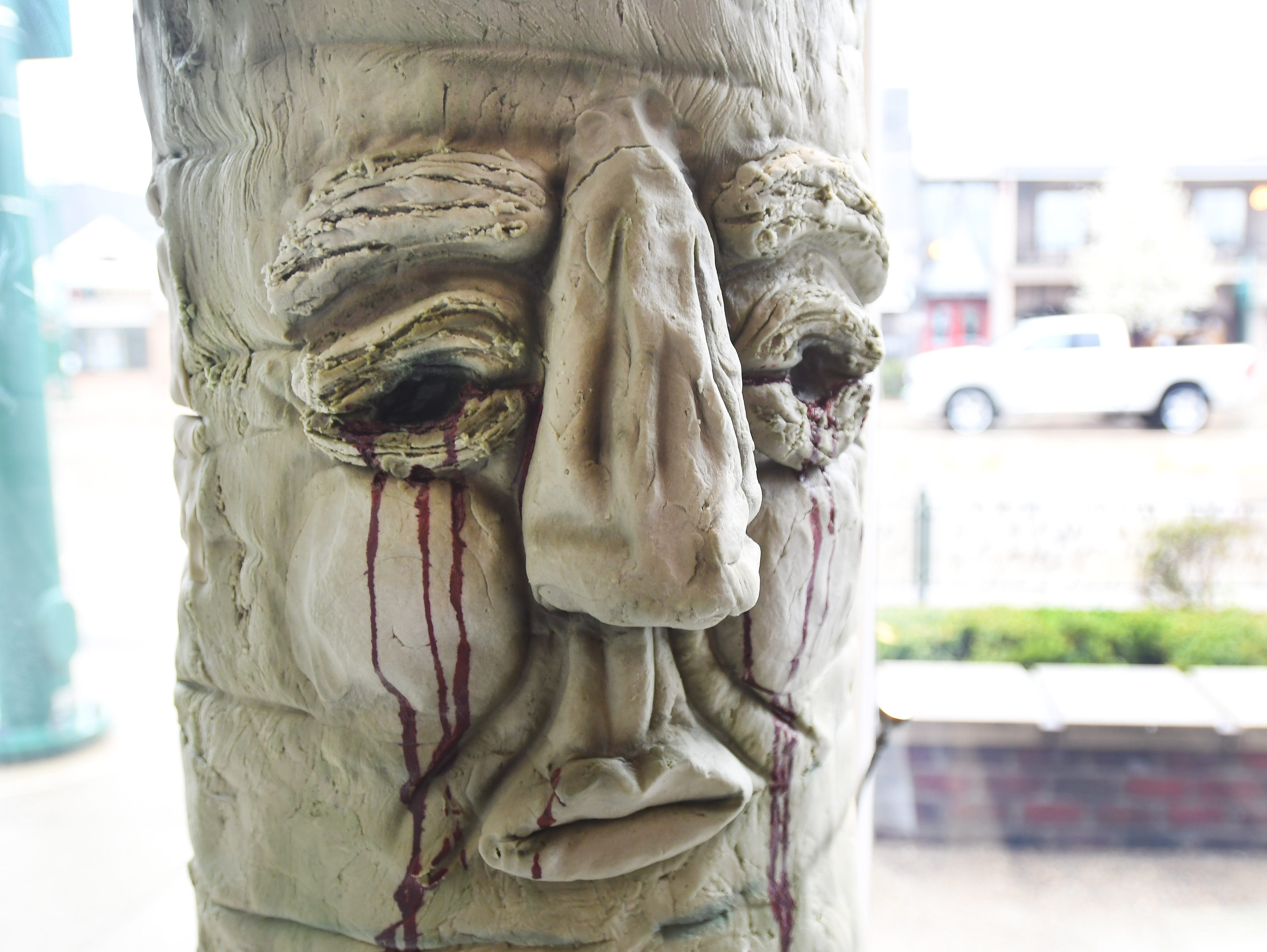 The bloodied face of the 'Weirwood' tree stares into the store.