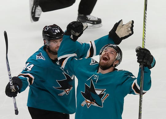 San Jose Sharks right wing Joonas Donskoi, right, celebrates with defenseman Marc-Edouard Vlasic (44) after scoring a goal against the Colorado Avalanche during the second period.