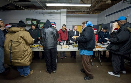 Homeless men are served a meal at the NSO Tumaini Center in Detroit, December 24, 2014.