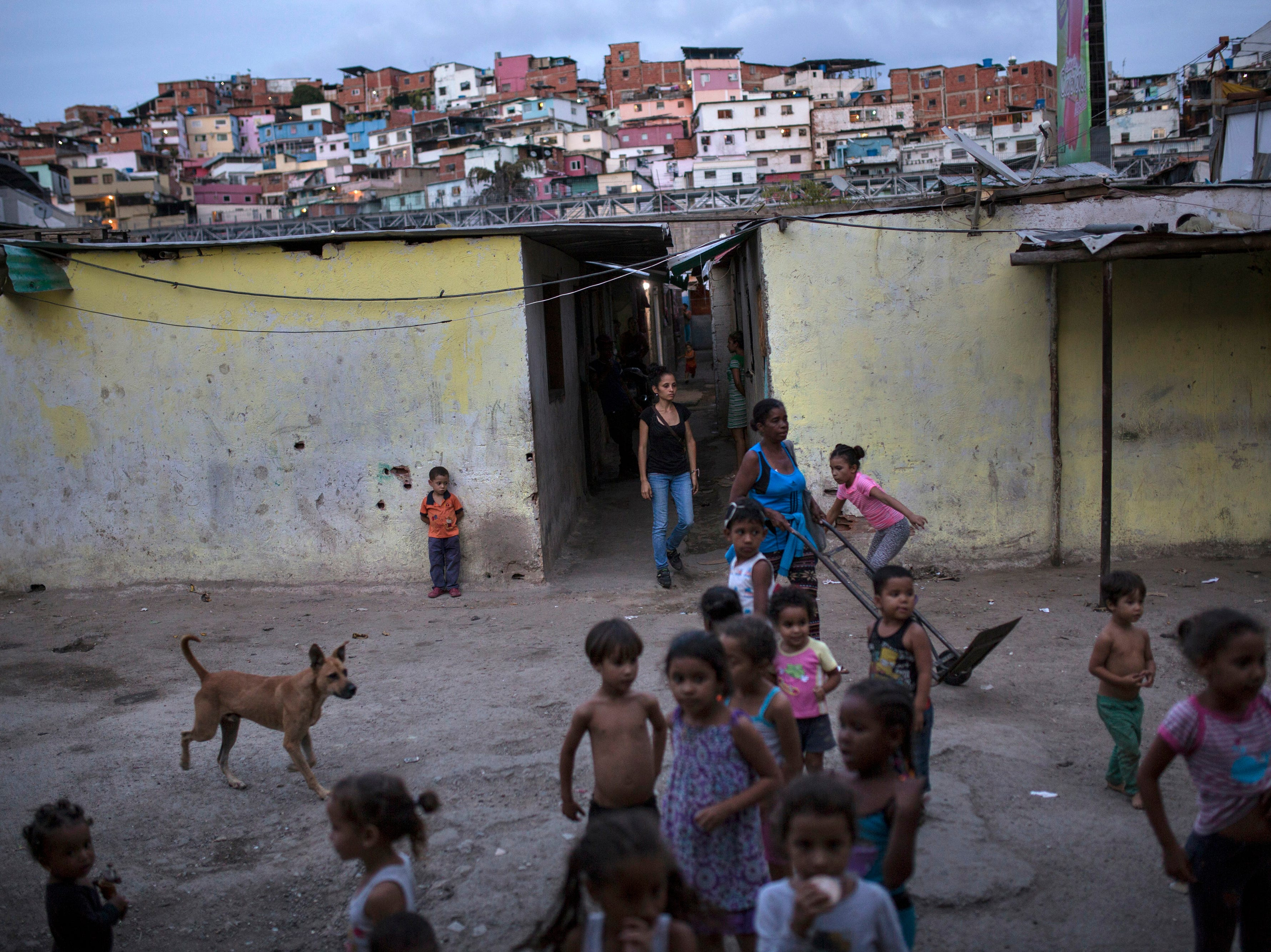 Children play at Los Hijos de Dios settlement, once an empty field owned by the government now occupied by about 60 families, in Caracas, Venezuela, Wednesday, May 8, 2019. More than 3 million Venezuelans have left their homeland in recent years amid skyrocketing inflation and shortages of food and medicine. U.S. administration officials have warned that 2 million more are expected to flee by the end of the year if the crisis continues in the oil-rich nation.