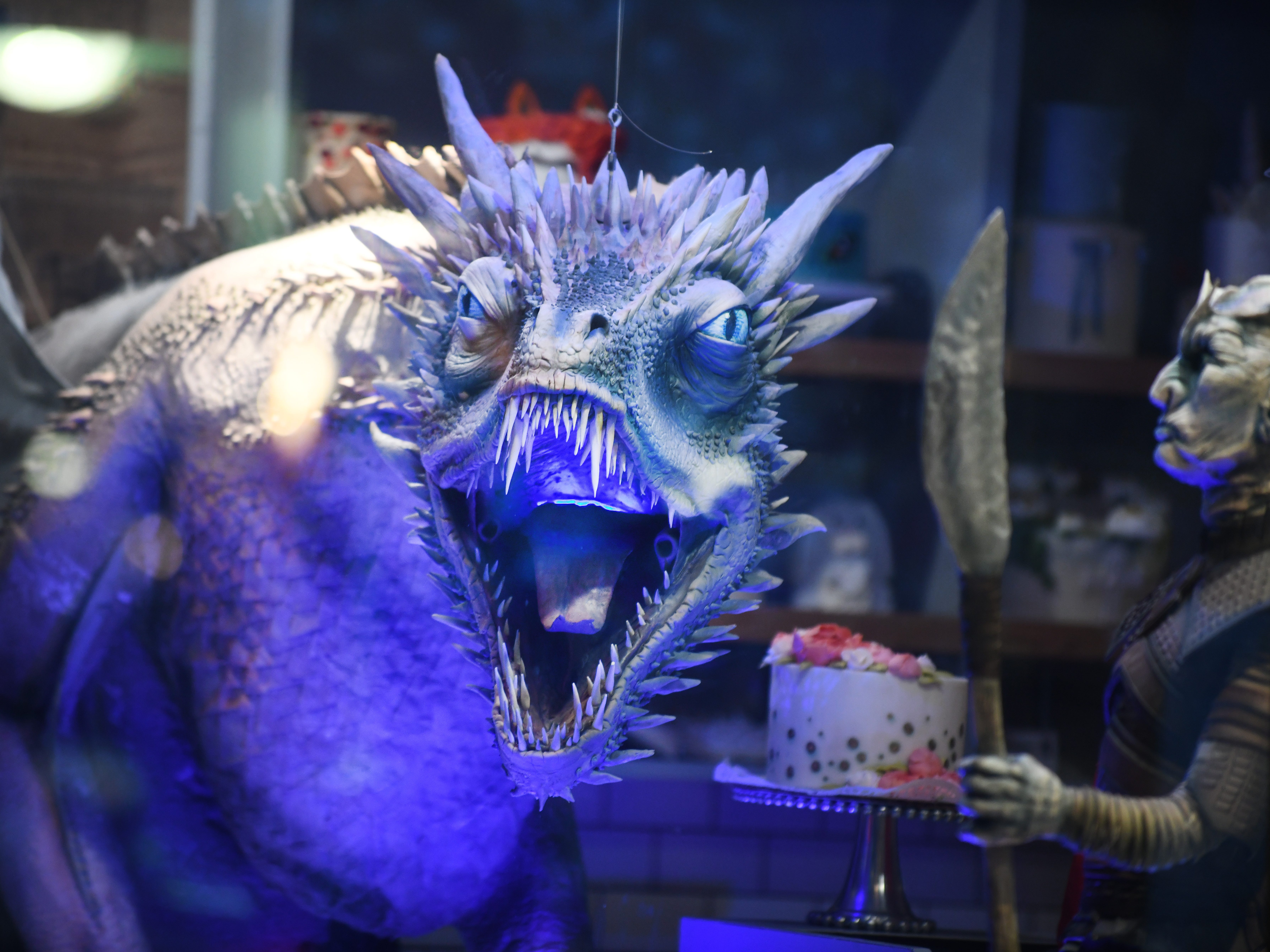 The dragon Viserion, who was turned into an ice dragon by the Night King,  turns his terrifying face toward passersby from the window of The Home Bakery.