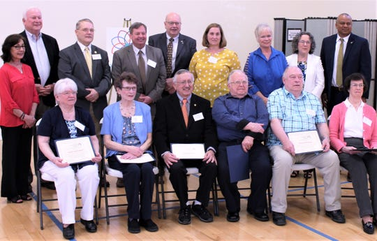 Government officials (back row) recently honored five volunteers as part of Older Americans Month. Front row, from left, are volunteers Evelyn Stachowski, Barbara Walker, Joseph Koczan, Phil Myers, Richard Northrop and Elsie Comstock.