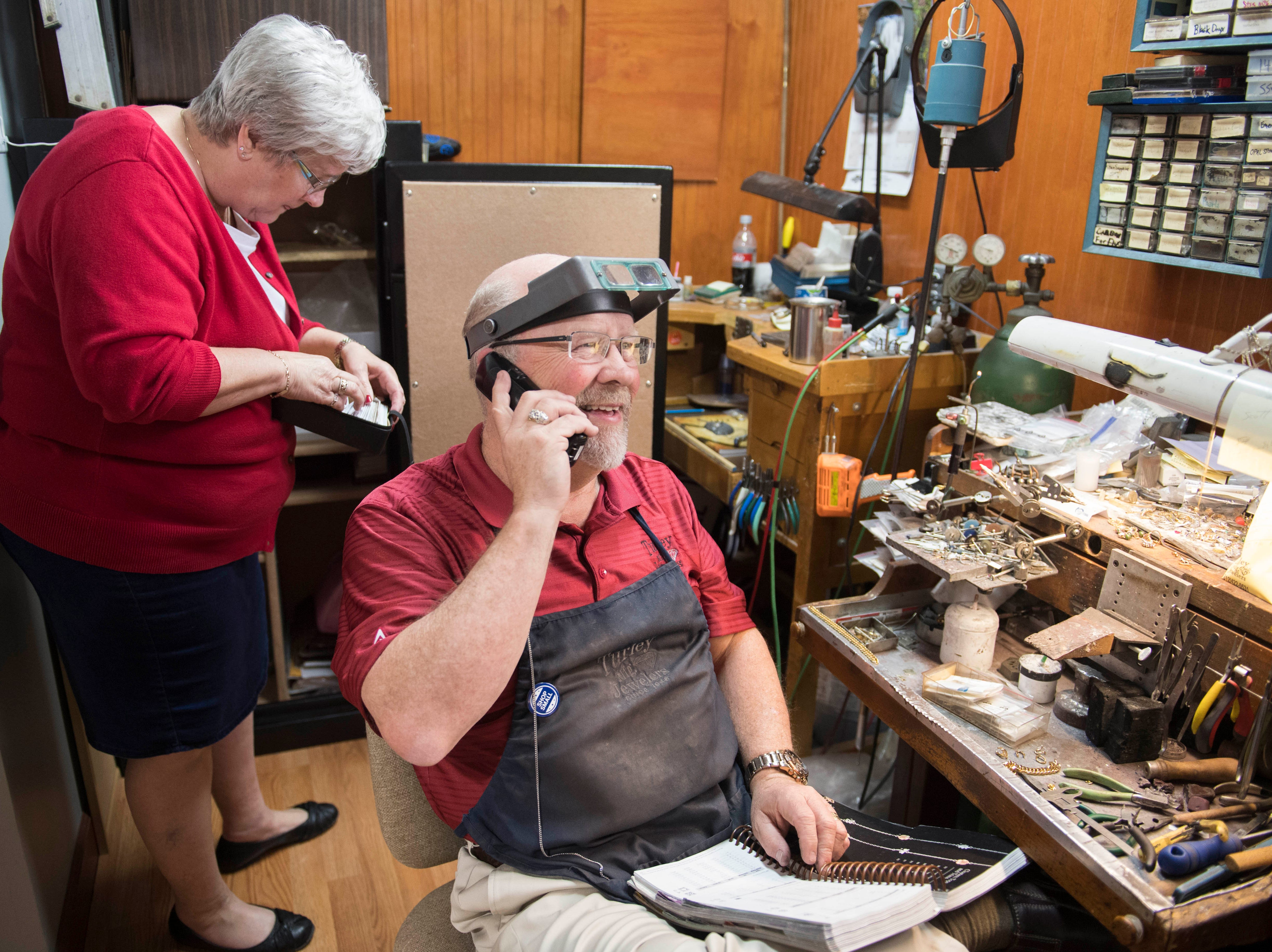 Joan Turley, left, looks for diamonds from the safe, while Bryan Turley, takes a phone call Wednesday, April 10, 2019. Turley Mfg. Jewelers is a third generation family own jewelry store in its 71st year in Downtown Evansville, Indiana.