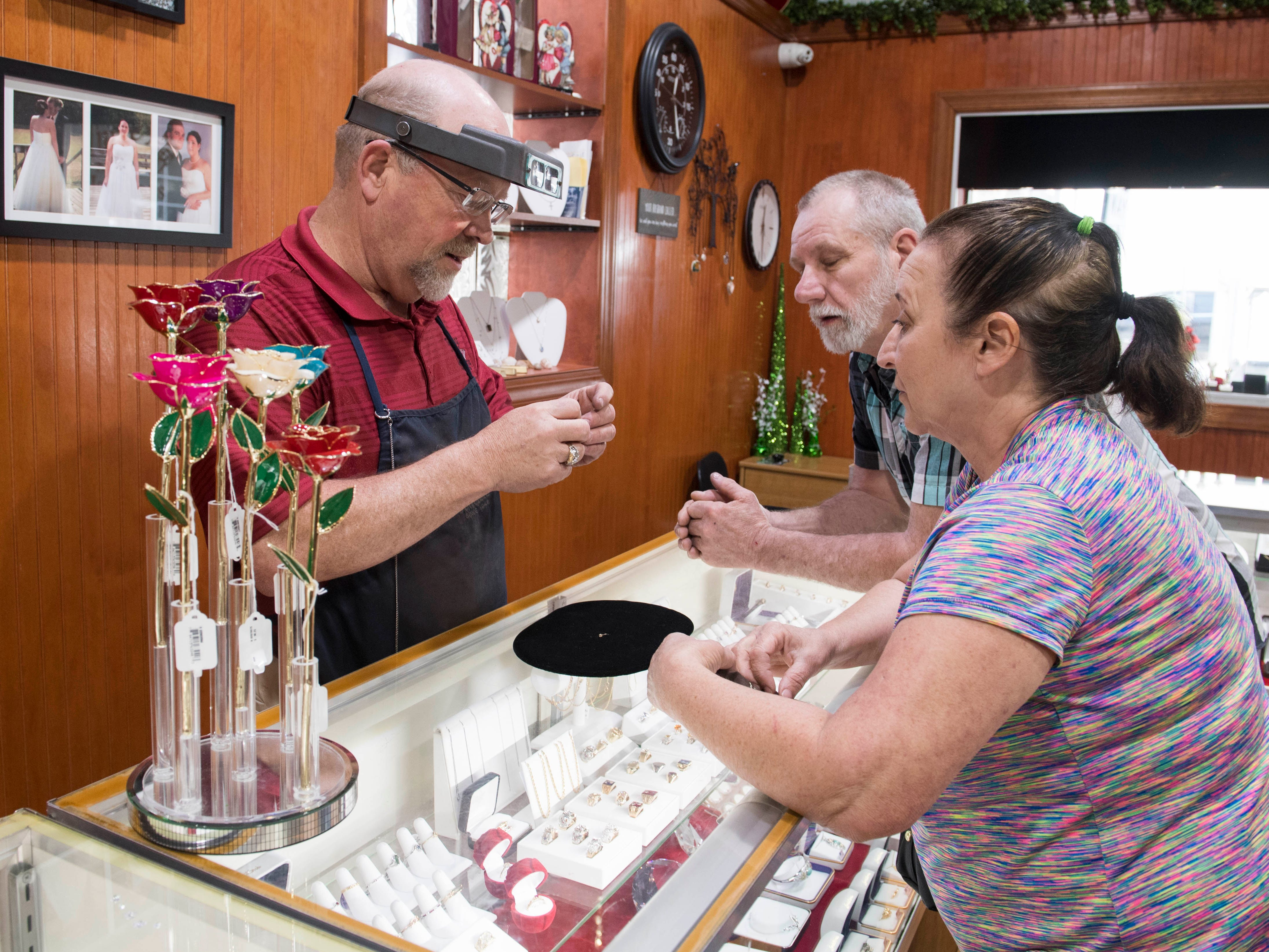 Owner Bryan Turley of Turley Mfg. Jewelers assist customers with earrings, Wednesday, April 10, 2019.