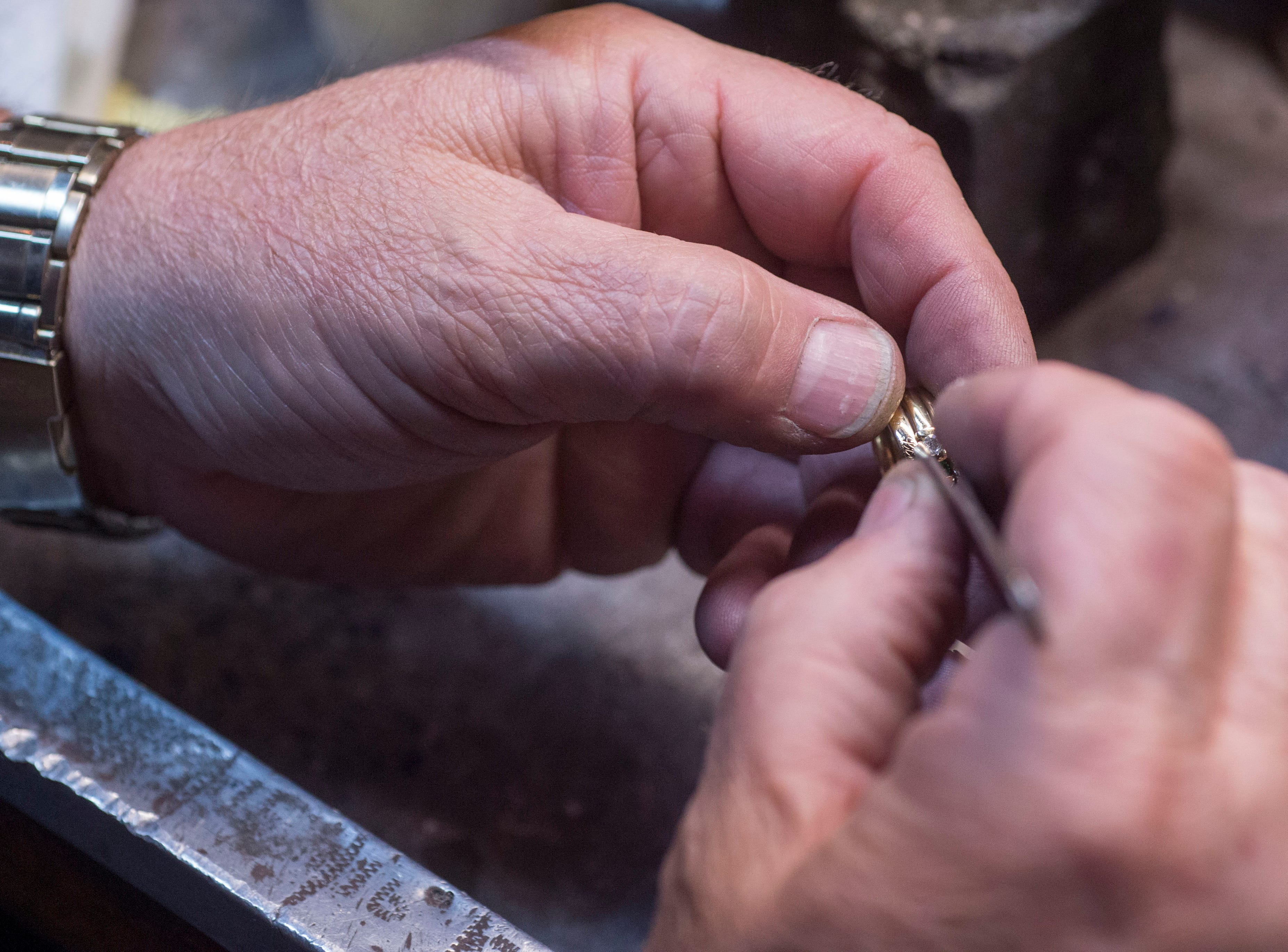 Bryan Turley, owner of Turley Mfg. Jewelers, works on a ring Thursday, April 11, 2019. Turley Mfg. Jewelers is a third generation family own jewelry store in its 71st year in Downtown Evansville, Indiana.