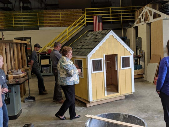Sandusky County Habitat for Humanity Executive Director Donna Thatcher thanks students at Vanguard from building a playhouse to be raffled off.