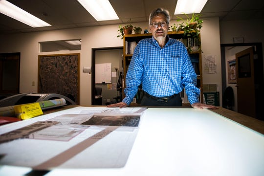 Senior planner with the city of Fort Collins Ted Shepard poses for a portrait at the light table that he used early in his career on Thursday, May 9, 2019, at the Fort Collins Building Services office in Fort Collins, Colo.