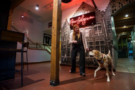 """Virginia Schetter and her three-year-old dog Curry practice walking up to the bar to order while maintaining during Summit Dog Training's """"Drink with Your Dog Brewery Manners"""" training class on Wednesday, May 8, 2019, at the New Belgium Brewing Company in Fort Collins, Colo."""