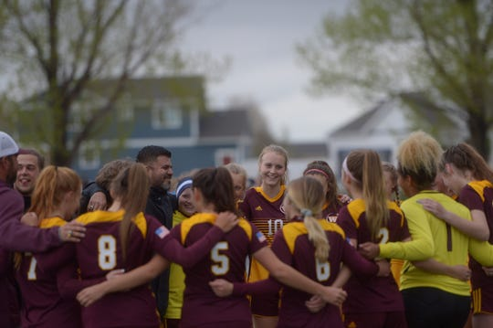 The Windsor girls soccer team huddles before a playoff game against Monarch on Tuesday, May 7, 2019.