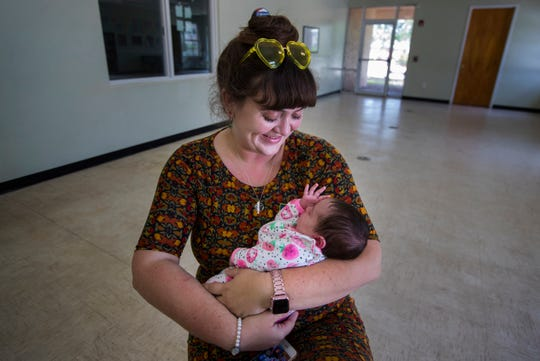 "Tiffany Bannworth cuddles her baby girl Amunet Corencia Pearl Bannworth. Tiffany's husband Stephen died in a motorcycle crash last year. Calling him the ""perfect husband"" he left her a lingering gift: A baby girl, born on Good Friday."