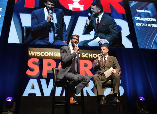 Olympic champion Michael Phelps talks with, host, Brett Christopherson during the Wisconsin High School Sports Awards show at the Fox Cities Performing Arts Center on Wednesday in Appleton.