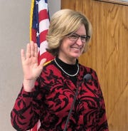 Marcia Ellis is seen taking the oath of office for the Oconto County Board on April 16.