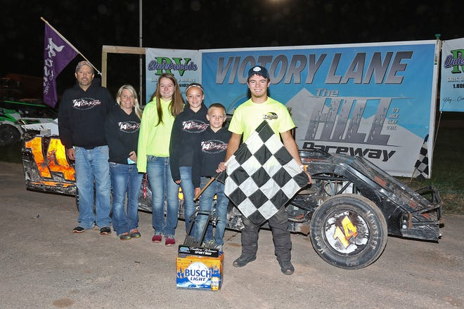 Cody Rass poses next to his family and his championship-winning race car at the end of the 2017 season at The Hill Raceway in Sturgeon Bay. The 20-year-old is returning to racing on a regular basis after taking 2018 off.