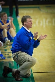 John Bostedt coached the Oconto High School boys basketball team for the past eight seasons.