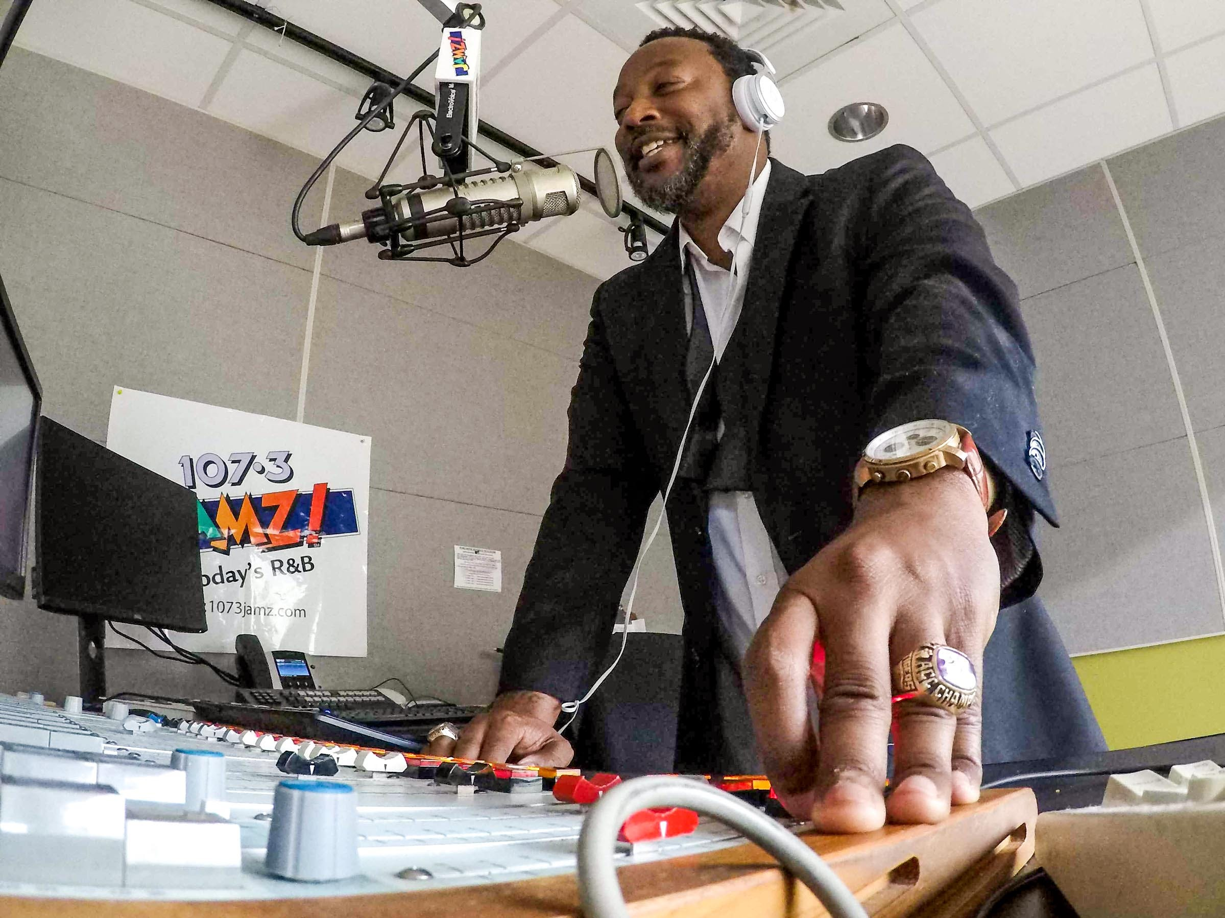 "Tone Hollywood (Tony Wheeler) of 107.3 FM JAMZ plays a song request, ""Hip Hop Hooray"" by 90s group Naughty by Nature at the station in downtown Greenville in May 2019."