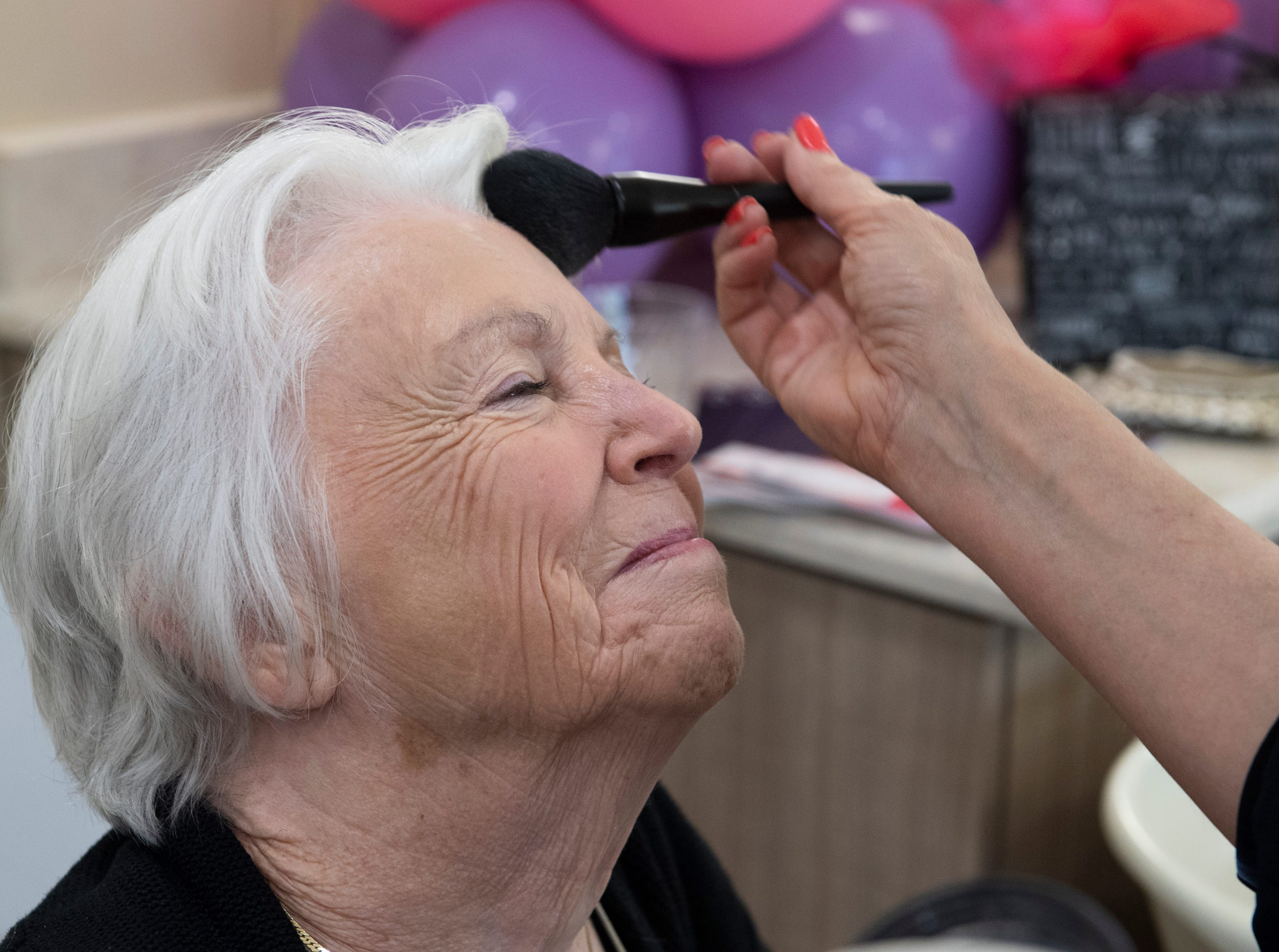 Harriet Barnett has her make-up done at Waterstone on Augusta Thursday, May 9, 2019. SYNERGY HomeCare of Greenville held a MotherÕs Day makeover party at the assisted living community.