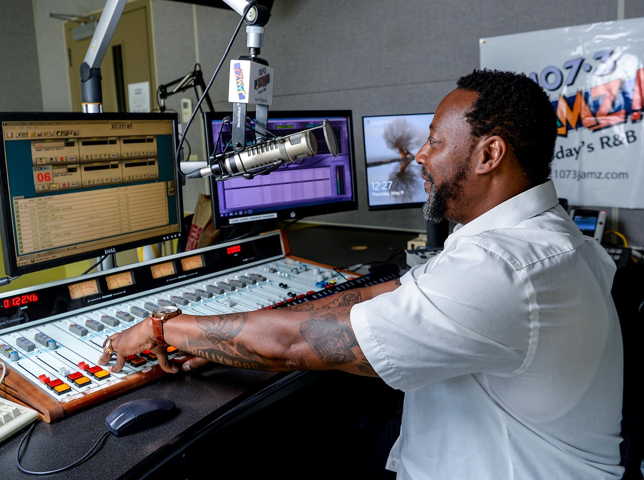 Tone Hollywood (Tony Wheeler) of 107.3 FM JAMZ stands by his computer getting ready for the next moment he speaks between songs played on the radio station in downtown Greenville in May 2019.