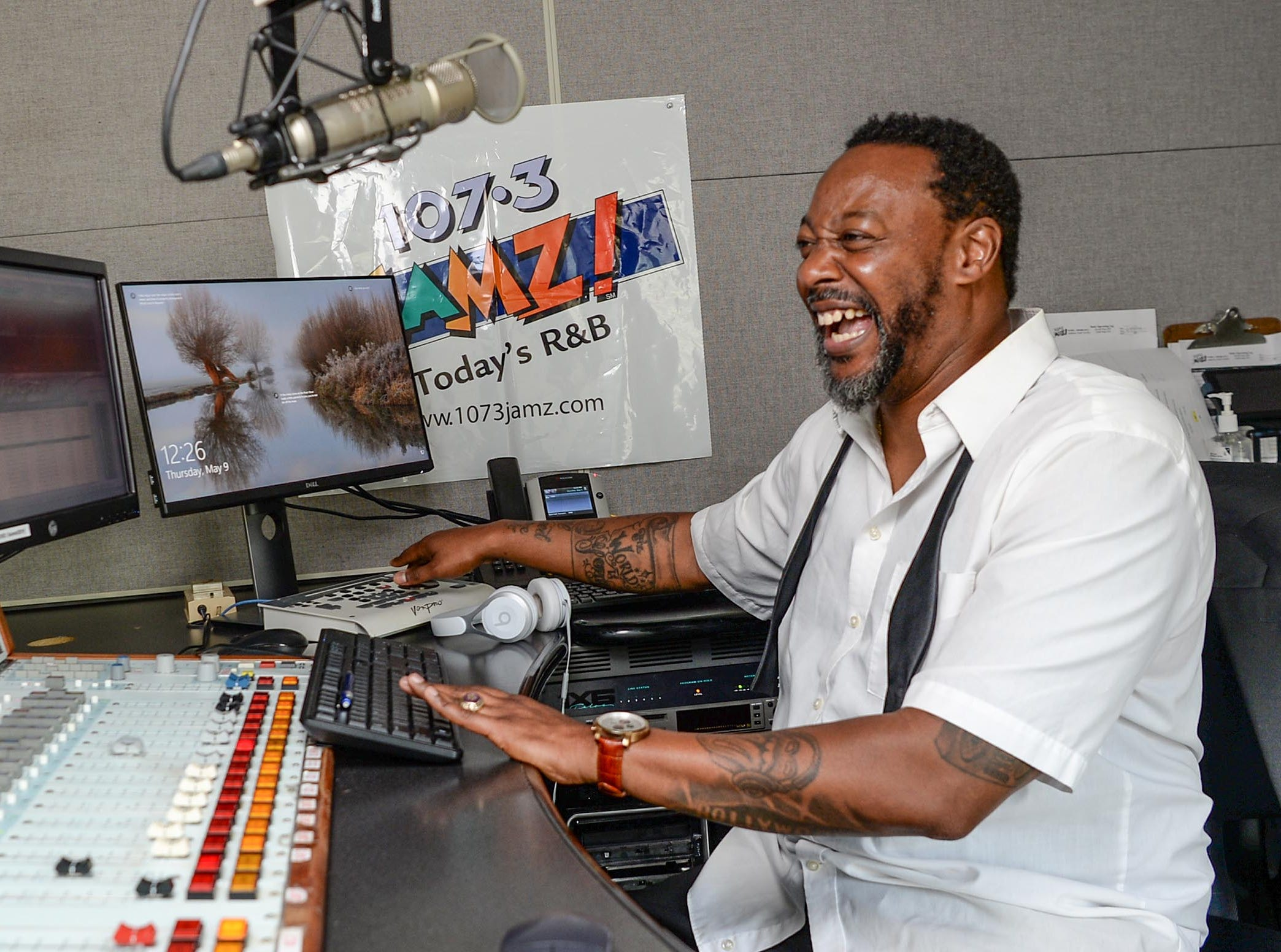 "Tone Hollywood (Tony Wheeler) of 107.3 FM JAMZ cues up a song request, ""Hip Hop Hooray"" by 90s group Naughty by Nature at the station in downtown Greenville in May 2019."