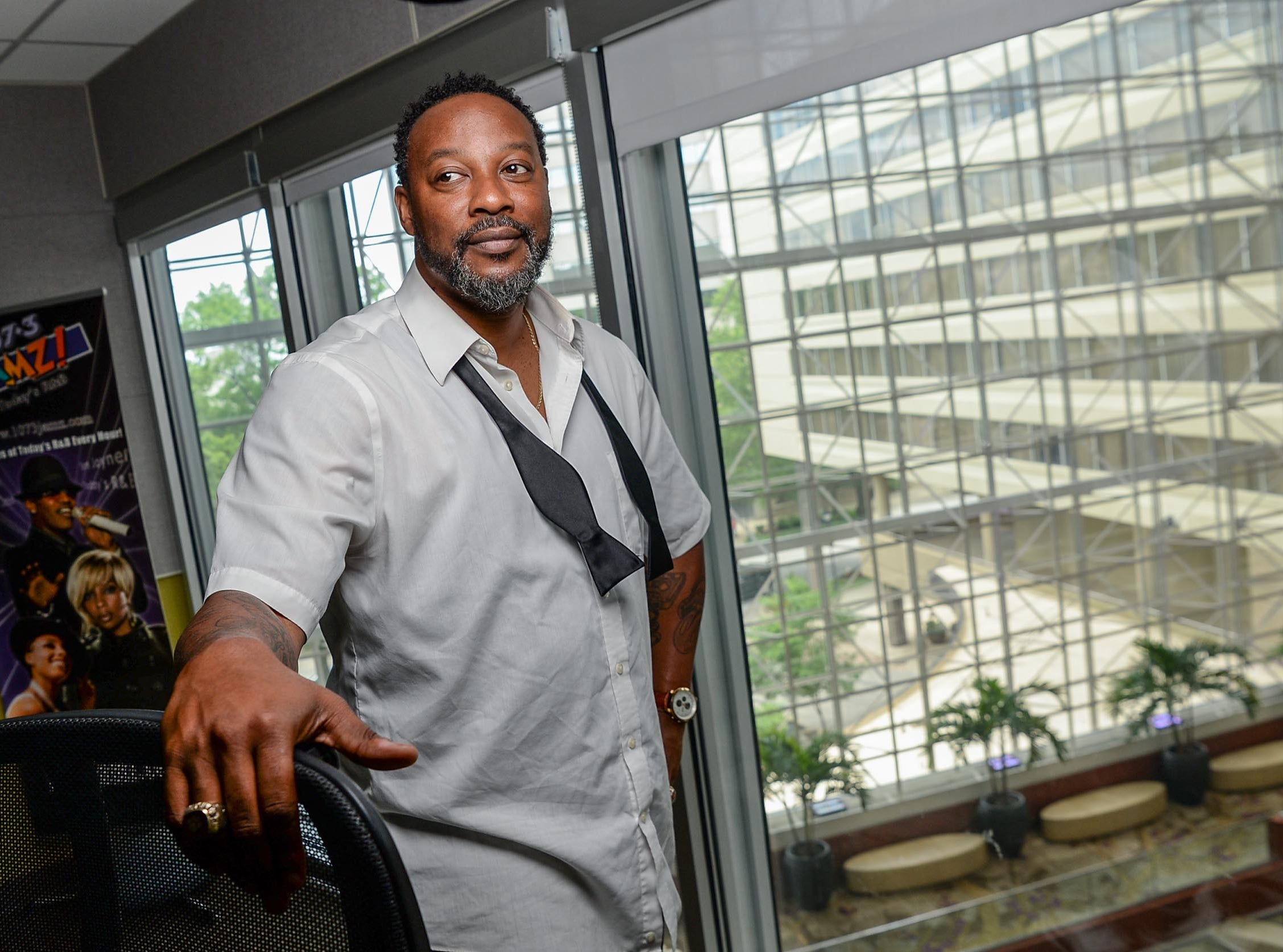 Tone Hollywood (Tony Wheeler) of 107.3 FM JAMZ in his studio office overlooking the Hyatt Regency atrium at the station in downtown Greenville in May 2019.