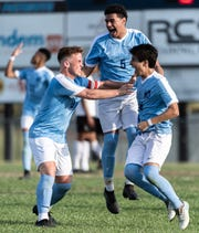 J.L Mann's Leo White, Brandon Agudelo and Saleem Al-Nawasreh celebrate after the first goal of their first round playoff game against Hillcrest scored by Al-Nawasreh Tuesday, Apr. 30, 2019. J.L Mann won 4-0.