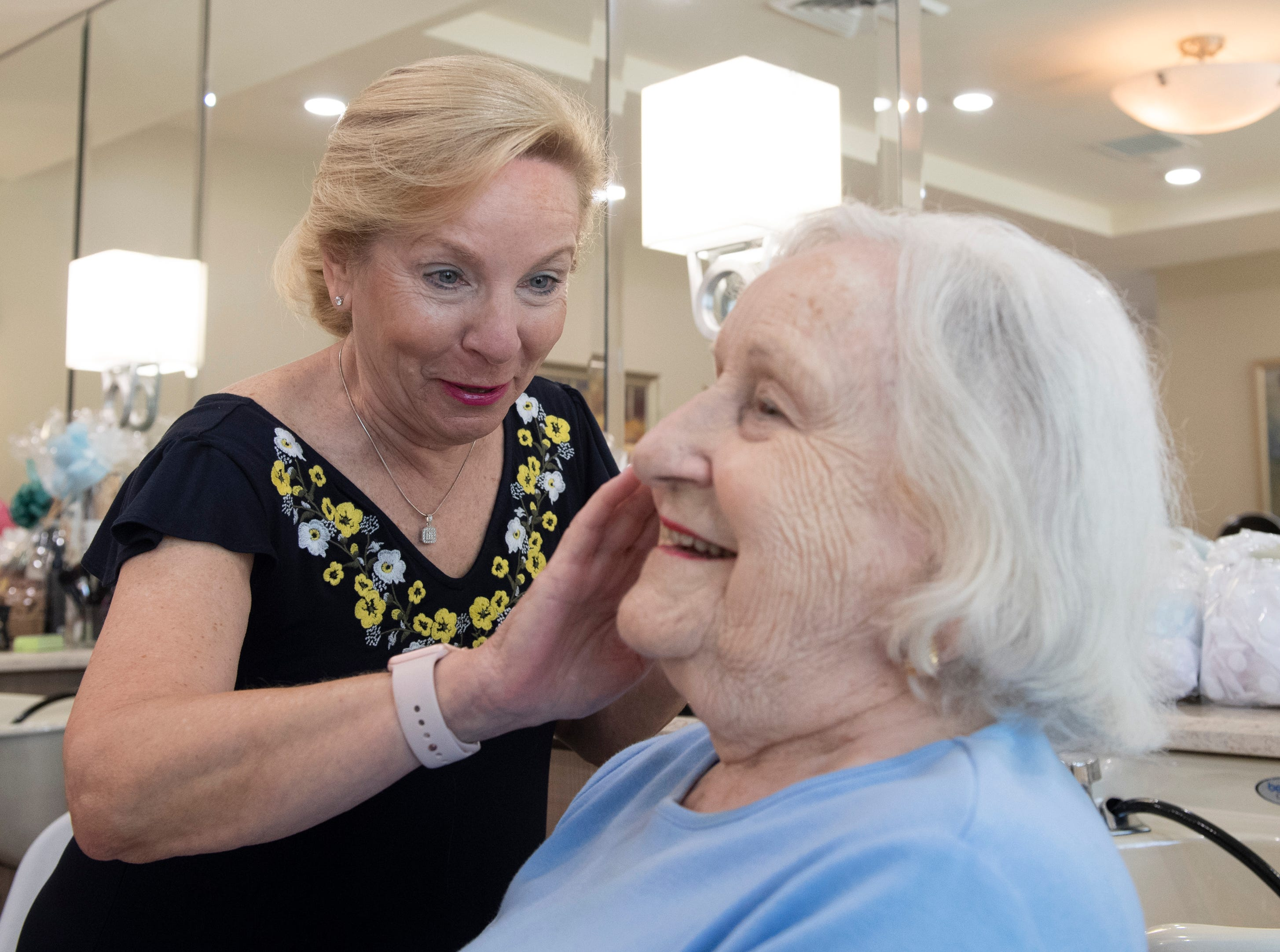Lynn Hopple applies a face mask to her mother, Audrey White at Waterstone on Augusta Thursday, May 9, 2019. SYNERGY HomeCare of Greenville held a Mother's Day makeover party at the assisted living community. Some residents came with their daughters who applied their facials and make-up.