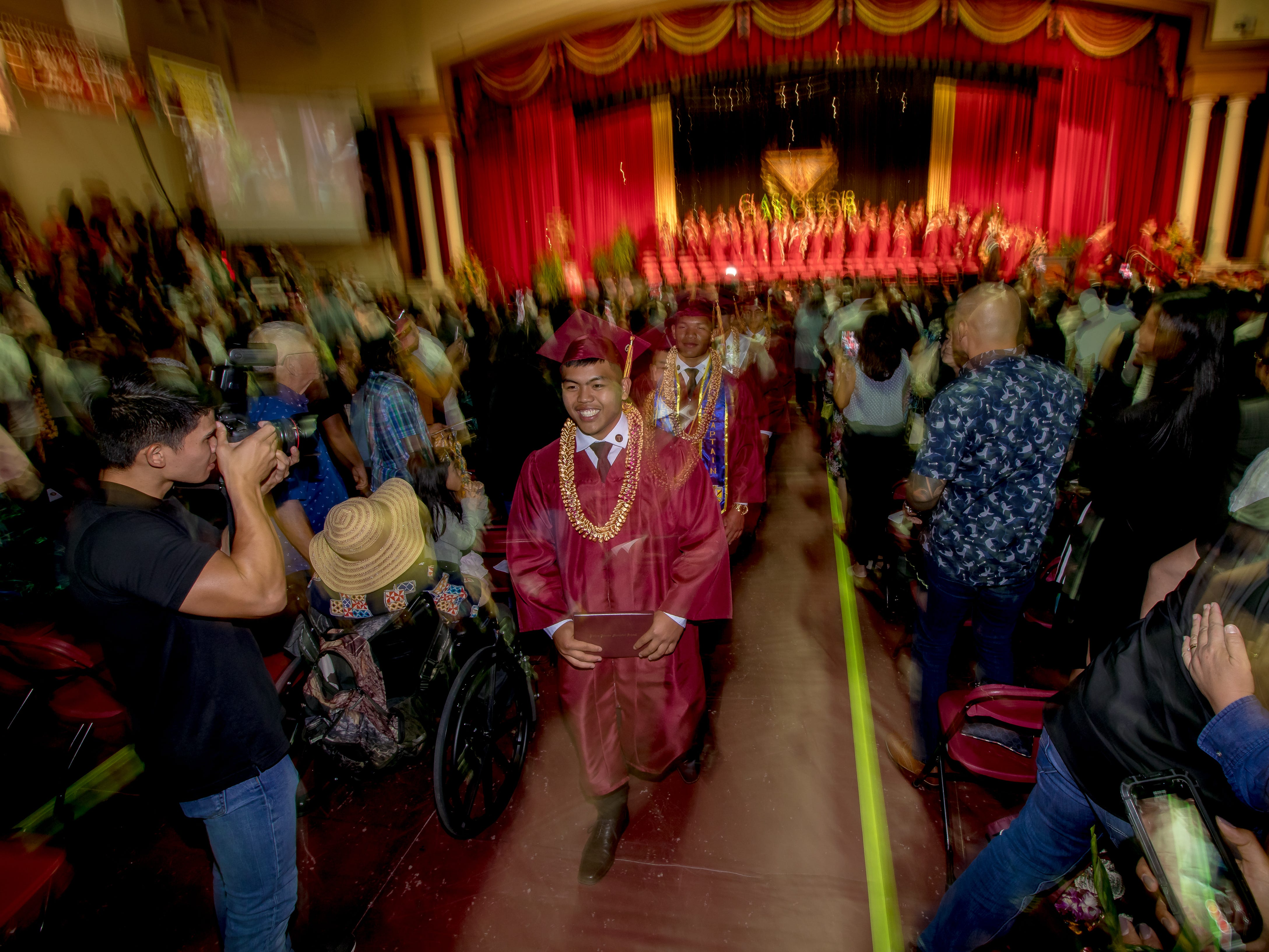 Father Duenas Memorial School Class of 2019 graduates parade out of the Phoenix Center after their commencement ceremony  in Mangilao on Wednesday, May 8, 2019.