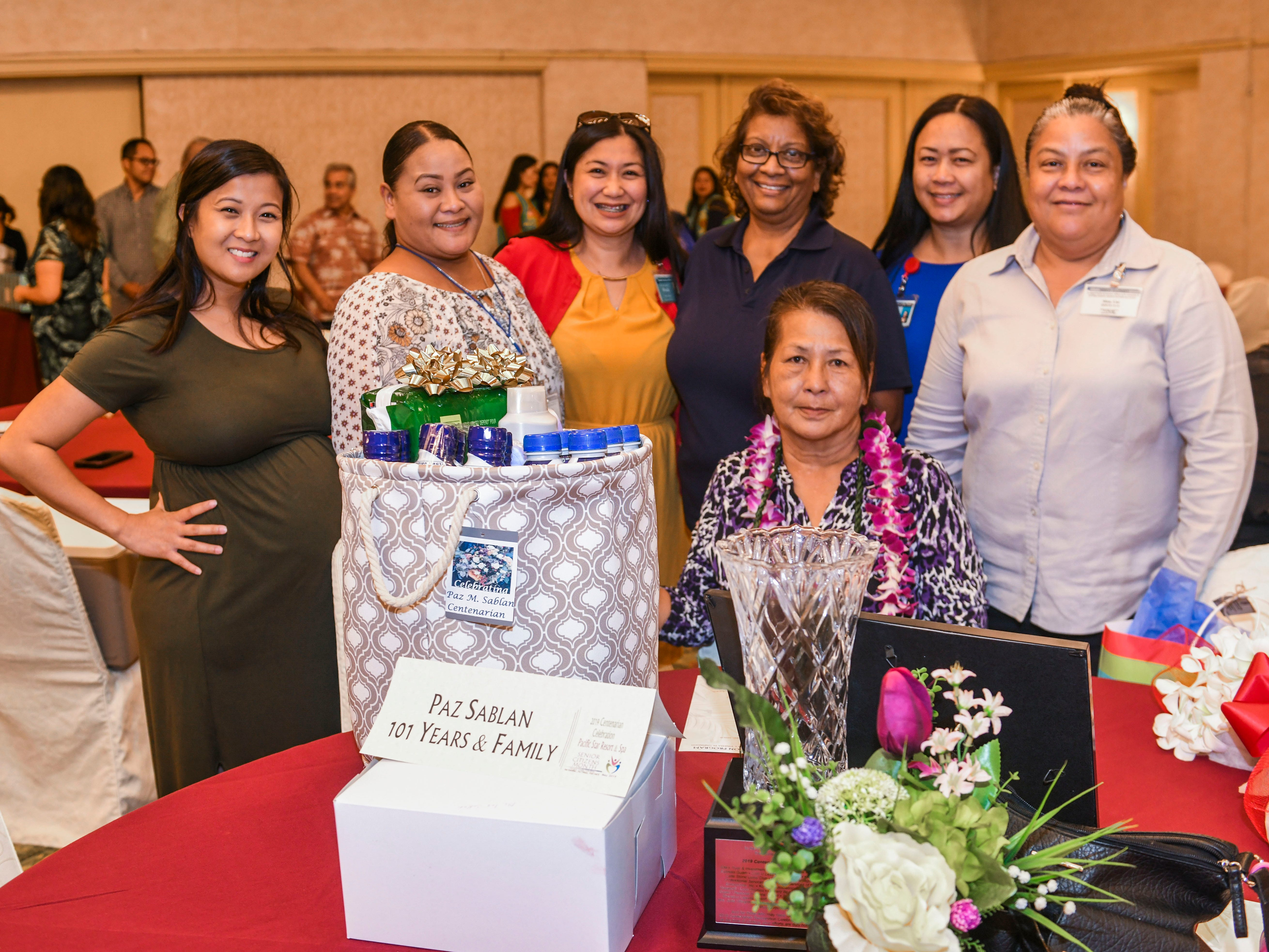 A family representative for centenarian Paz Sablan is presented with gifts for her from the Health Services of the Pacific during the 2019 Centenarian Celebration at the Pacific Star Resort & Spa in Tumon on Thursday, May 9, 2019. The event, hosted by the Department of Public Health and Social Services, was held in conjunction with Senior Citizens Month.