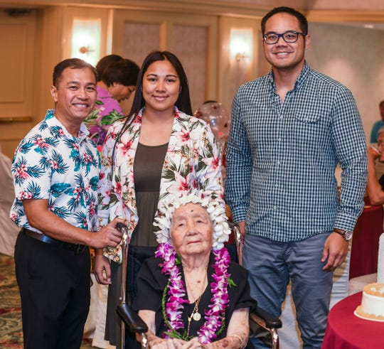 Josephina Dorotea Yamanaka Blas, 103, seated, gathers with family and friends during the 2019 Centenarian Celebration, hosted by the Department of Public Health and Social Services, held in conjunction with Senior Citizens Month, at the Pacific Star Resort & Spa in Tumon on Thursday, May 9, 2019.